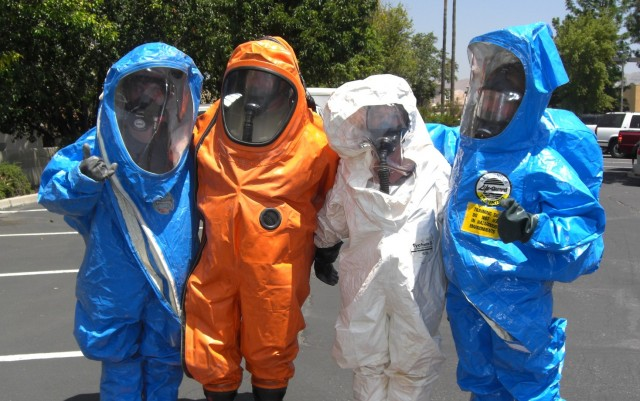 Workers wearing PPE and respiratory protection devices