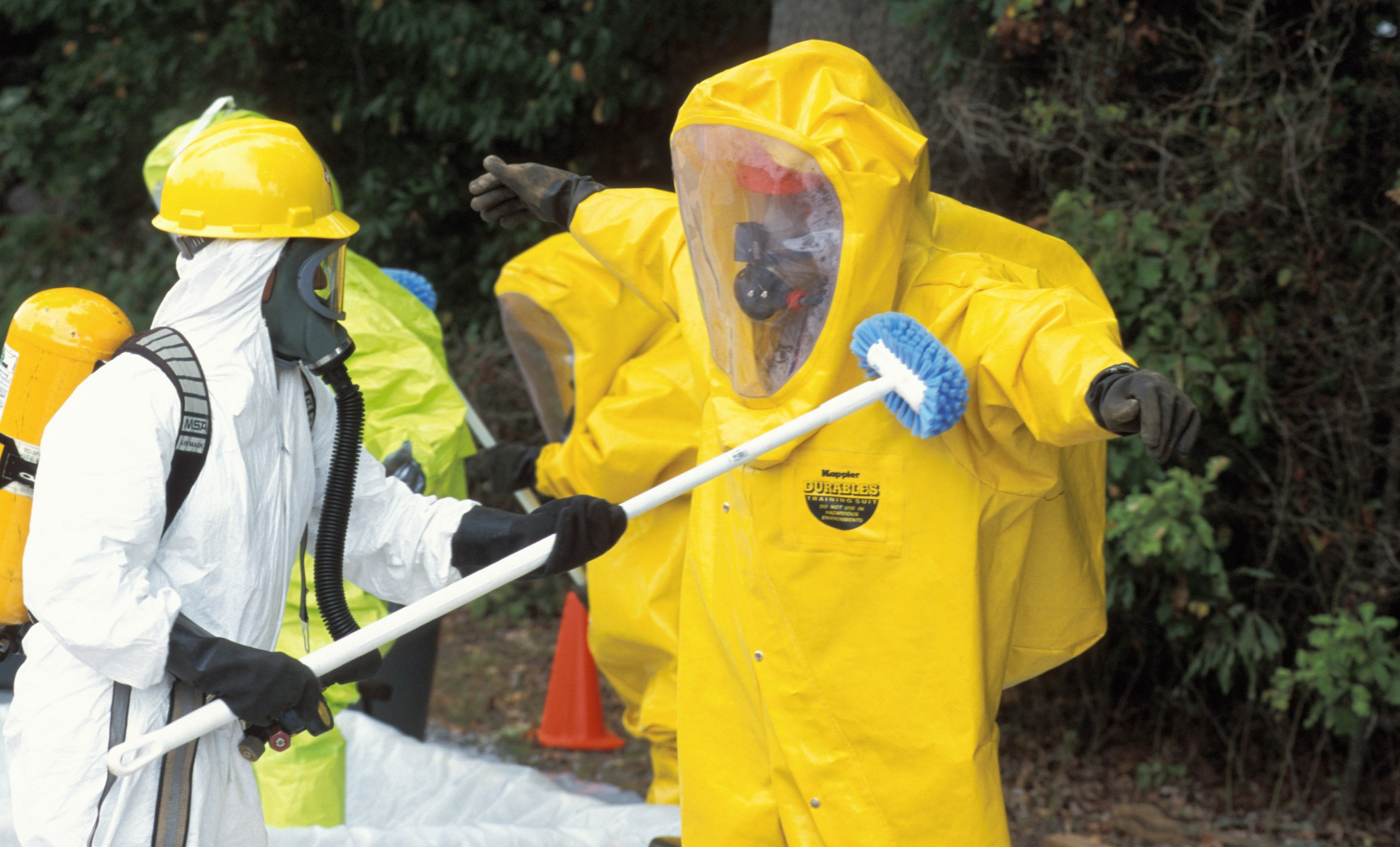 Hazardous waste decontamination of man wearing PPE