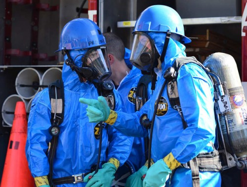 Hazmat workers wearing personal protective equipment