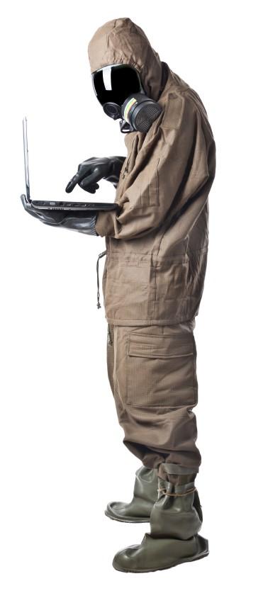 Worker in PPE taking online training on laptop