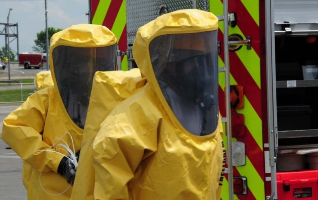 Men in HAZMAT PPE preparing for emergency response